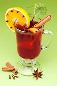 Glass Of Mulled Green On A Green. Stock Photos