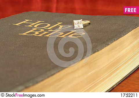 Free Engagement Ring On Bible Stock Image - 1752211