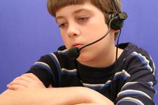 Free Young Boy On Telephone Blue Background Royalty Free Stock Photo - 1752305
