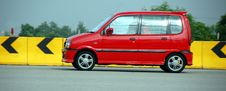 Red Compact Saloon Car Stock Image