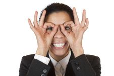 Woman Looks Through Finger Binoculars Royalty Free Stock Photos