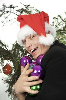 Free Man Holds An Armful Of Fur-tree Toys Stock Photos - 17501543