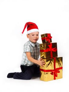 Free Boy In Santa Hat With A Bunch Of Gifts Stock Images - 17502324