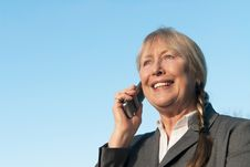 Free Happy Mature Businesswoman Using Cellphone. Royalty Free Stock Photos - 17505058