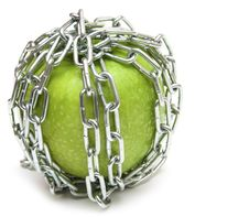 Free Apple With Chains Stock Images - 17510594