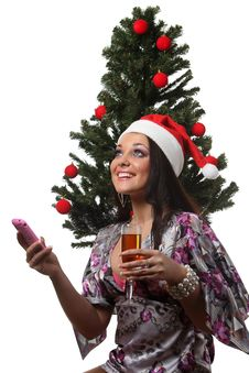 Free Woman Speak Mobile In Front Of A Christmas Tree Stock Images - 17511964