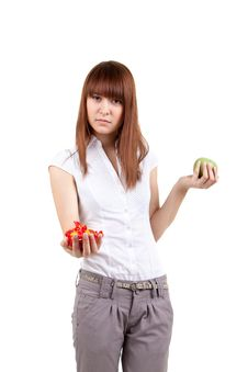 The Girl With Sweets And An Apple Stock Photography