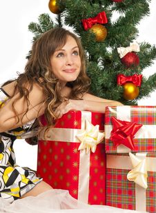 Girl With Gift Boxes Stock Photo
