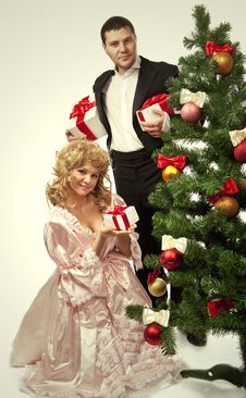 Free Victorian Couple Near A Christmas Tree Royalty Free Stock Photo - 17515825