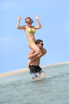Free Happy Couple Having Fun On The Beach Royalty Free Stock Image - 17515856