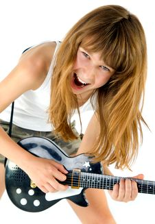 Free Girl Playing The Guitar Royalty Free Stock Photo - 17517565