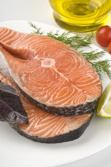 Raw Salmon Steak With Herbs Royalty Free Stock Photos