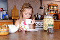 Free Girl Blowing To Cup Of Hot Drink Royalty Free Stock Image - 17520506
