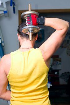 Man Training In Fitness Center Stock Photo