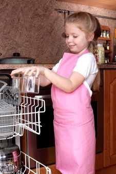 Girl Taken Clear Glass From Dishwasher Stock Image