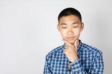 Free Chinese Boy Thinking Royalty Free Stock Photography - 17521227