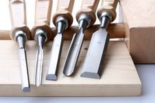 Set Of Chisels And Wooden Plate Royalty Free Stock Image