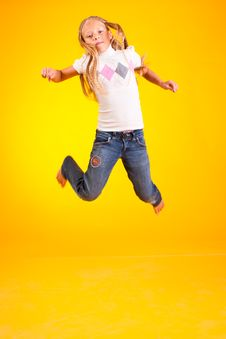 A Merry Girl Jumps Stock Image
