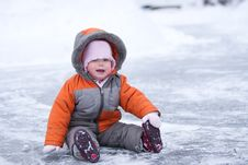 Free Cute Wondered Baby Sit On Lake S Ice And Smile Royalty Free Stock Images - 17526039