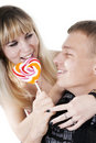 Free Couple Eating Lollypop Shape Of Heart Stock Images - 17538284