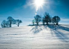 Free Sun Over Snowy Hill Stock Image - 17530891