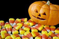Free Jack-o-lantern With Candy Corn On Black Stock Photo - 17531600