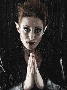 Free Beautiful Vampire Woman Behind Rainy Window Royalty Free Stock Photos - 17532108