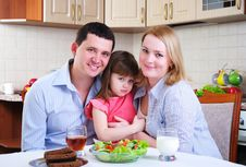 Dad, Mom And Their Little Daughter Royalty Free Stock Photos