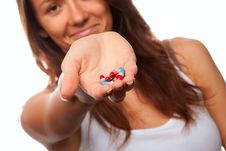 Free Doctor Offering Pill Capsules Royalty Free Stock Image - 17536036