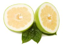 Fresh Juicy Grapefruits With Green Leafs Royalty Free Stock Images