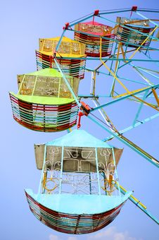 Free Vivid Colored Ferris Wheel Against The Blue Sky Royalty Free Stock Image - 17536986