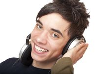 Free Teenager With Headphones Listens To Mp3 Dusic Stock Photos - 17537183