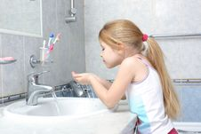 Free Girl Washing In Bathroom Stock Image - 17538191