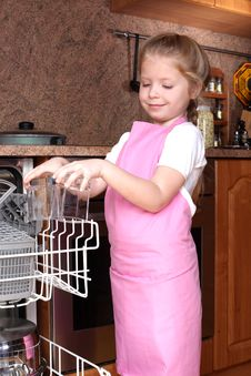 Girl Taken Clear Glass From Dishwasher Royalty Free Stock Photo