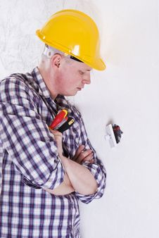 Free Electrician Installing A Switch Stock Photo - 17538270