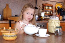 Girl With Teapot And Cup Of Hot Drink Stock Photography