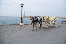 Coach Before Chania Lighthouse . Royalty Free Stock Photography