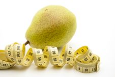 Pear With Tape Measure Royalty Free Stock Photo
