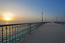 Free Sunrise Over The Ocean At A Pier Royalty Free Stock Image - 17540886
