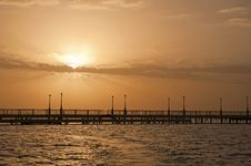 Free Sunrise Over The Ocean At A Pier Royalty Free Stock Images - 17540949
