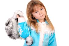 Free Girl Holds In A Hand A Winter Fur Cap Royalty Free Stock Photo - 17542275