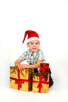 Free Boy In Santa Hat With A Bunch Of Gifts Royalty Free Stock Photo - 17542785