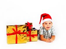 Boy In Santa Hat With A Bunch Of Gifts Stock Image