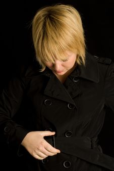 Free Blond Woman And Black Trench Coat Royalty Free Stock Image - 17544296