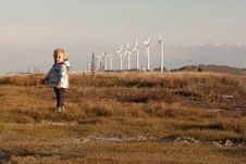 Child And Windmills Stock Image