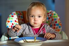 Free Little Girl Eats Porridge Royalty Free Stock Photos - 17545358