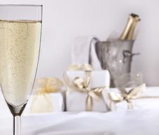 Glass Of Champagne And Gifts Royalty Free Stock Photo