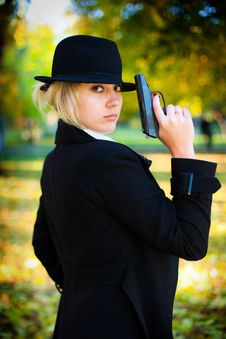 Free A Girl Holding A Gun. Royalty Free Stock Photo - 17546425