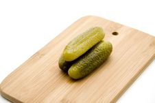 Gherkins On Edge Board Stock Photos