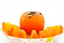 Persimmon In A Dish Stock Photos